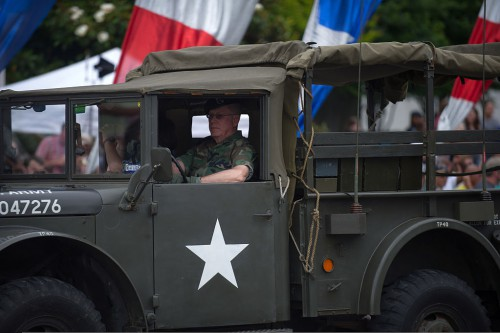 A_U.S._veteran_drives_a_vintage_military_vehicle_in_the_2013_National_Memorial_Day_Parade_in_Washington,_D.C.,_May_27,_2013_130527-A-AO884-183