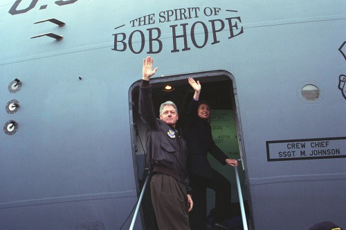 The_Clintons_wave_from_the_doorway_of_The_Spirit_of_Bob_Hope_airplane_on_departing_from_Sarajevo_en_route_to_Tuzla_-_Flickr_-_The_Central_Intelligence_Agency